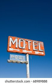 An old vintage, neon sign points to a motel that was never built.  Lots of copy space.