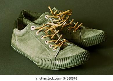 Old vintage pair of sports footwear
