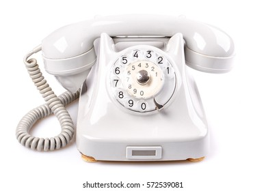Old vintage phone with rotary dial isolated on white background. Analog retro disk telephone.