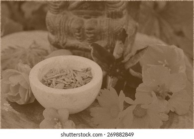 Old vintage photo style postcard red sandalwood chips cut (santali rubri, gabun) stone bowl ritual offering indian elephant god ganesha different fall / autumn flowers leaves (rose, calendula, etc)
