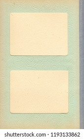 Old vintage photoalbum page with two blank photo frames