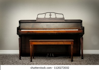 Old vintage piano in home for music with rich wood tones and colors music musical