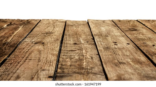 Old vintage planked wood table in perspective on white background