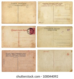 Old Vintage Postcards. Set of aged vintage postcards from early 1900. Comes on white background, isolated with clipping path.