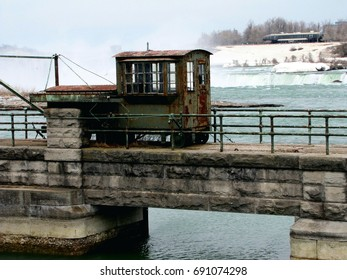 Old vintage rail- car sits above the churning waters of the Niagara River in the winter.