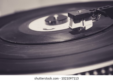 An old vintage record palyer with vynil