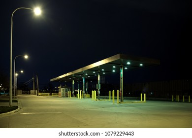 Old vintage retro industrial gas station at night