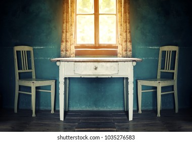 old  vintage room with table and two chairs and sun shining through the window