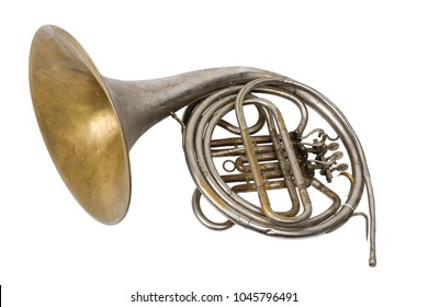Old vintage rusty French horn on a withe background, isolated