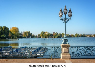 Old vintage street lamp on the lake of Enghien les Bains near Paris, France