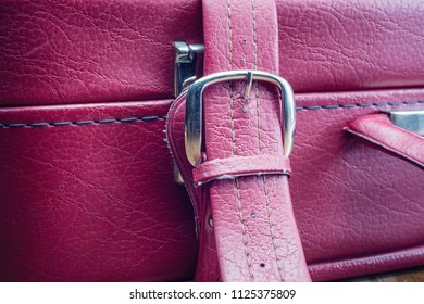 Old vintage suitcase buckle with straps - close up