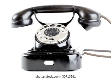 Old vintage telephone on white background