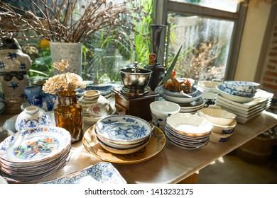 old vintage thai ceramic table ware on table
