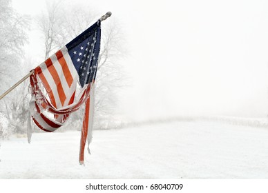 Old Vintage torn American Flag with frost and snow
