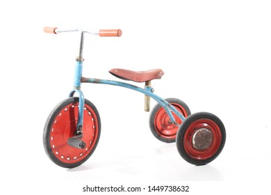 old vintage tricycle on white background