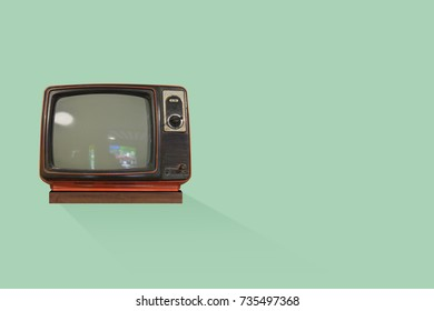 Old vintage TV television isolated on green background. This has clipping path.