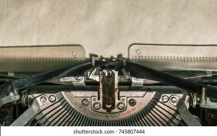 Old vintage typewriter with blank paper. close-up
