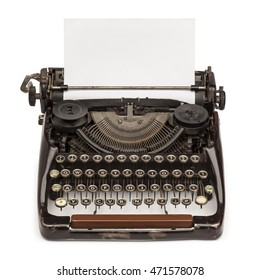 Old vintage typewriter and a blank sheet of paper inserted, isolated on white