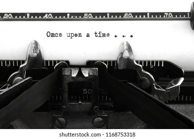 Old vintage typewriter keys and characters with words once upon a time story beginning