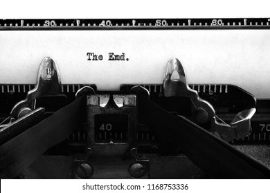 Old vintage typewriter keys and characters with typed words the end for story ending