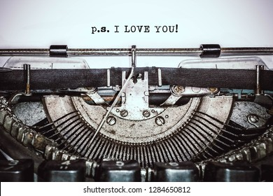 "Old vintage typewriter, retro machine with white sheet of paper and typed text ""p.s. I LOVE YOU!"", copy space, close up"