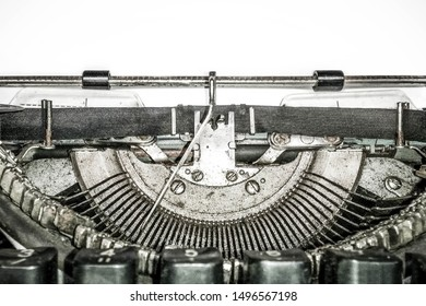 Old vintage typewriter, retro machine with white sheet of paper, copy space, close up