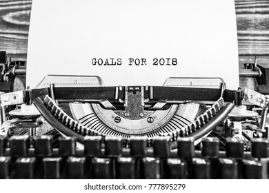 Old vintage typewriter with sample text Goals for 2018. on white paper