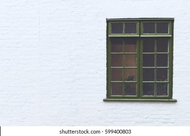 Old vintage, urban beautiful, green house window in a white outside brick wall, isolated, background.