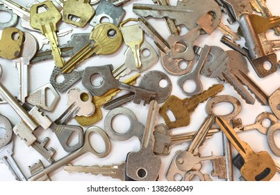 Old vintage various keys pattern. Antique metal gold bronze silver color different clue for padlock. Chaotically mix flat lay top view composition