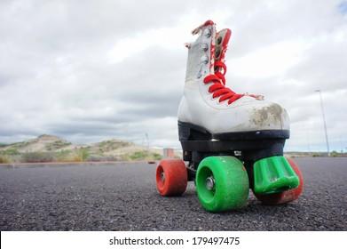 Old Vintage White Skate Boot on the Asphalt Sterret
