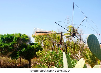 old vintage windmill and a cactus in Sissi on Crete in Greece