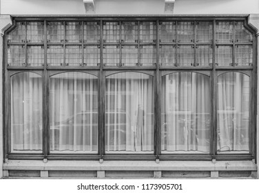 Old vintage wooden boutique shop caffe facade window decorated showcase