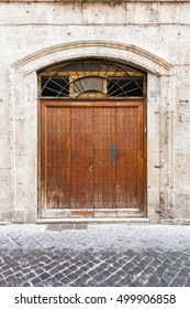 old vintage wooden door in a house in Rome, Italy