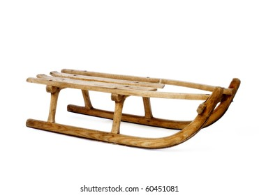 Old vintage wooden sled on white