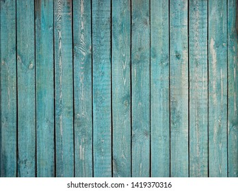 Old vintage wooden wall with blue peeling paint