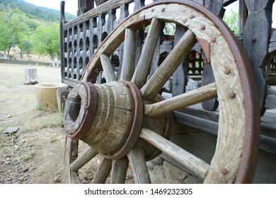 old (vintage) wooden wheel. 19th century wagon wooden wheel. antique metal parts made in the forge