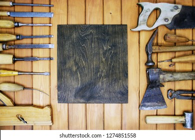 Old vintage woodworking tools  on wooden board