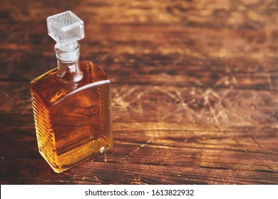 Old vintge photo of Bottle of whiskey on wooden table