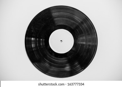 Old vinyl music record on wall