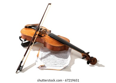 Old violin bow and notes crossed isolated on white
