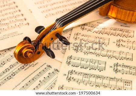 Old Violin Lying On Sheet Music Stock Photo (Edit Now