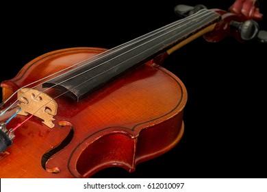 Old violin on a black background
