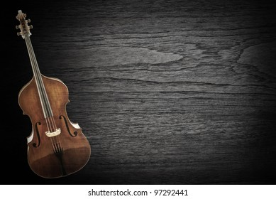 Old violin on wood texture ,vintage  background