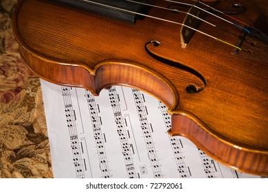 old violin over score