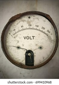 Old voltage meter. Zero to two hundred forty. Metering system broken.