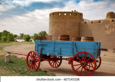 Old wagon in front of historic adobe Bent's Fort in La Junta, Colorado