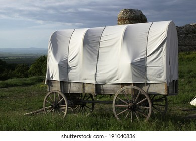 The old wagon stands in the old town