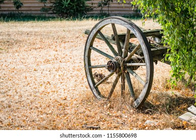 Old wagon wheel on a carriage in the fall abandoned bu settlers in the wild west