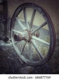 Old wagon wheel in small western town in Utah.