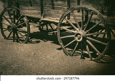 Old wagon wheel symbolic of American Wild West Cowboy concept